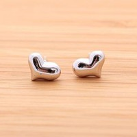 EMBOSSED HEART stud earrings in silver by bythecoco on Zibbet