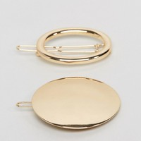 ASOS Pack of 2 Solid and Open Circle Hair Clips at asos.com
