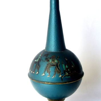 Vintage unique blue small copper vase. Ancient Israeli landscape. Camels and middle eastern buildings.