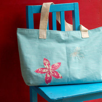 Beach large tote bag with flower and bee on aqua denim