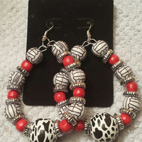 African inspired wire earring with black white and red beading.