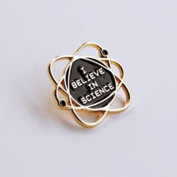 The Betty Collection: I Believe in Science Pin in Black and Gold
