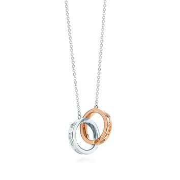 Tiffany & Co. - Tiffany 1837™ interlocking circles pendant in sterling silver and 18k rose gold.