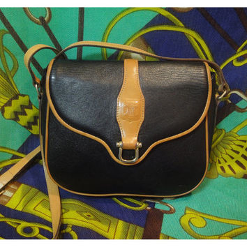 Vintage Celine black and brown genuine leather shoulder purse with an embossed logo and gold tone hardware. riri zipper