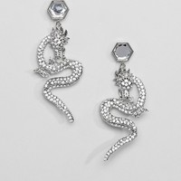 ASOS DESIGN earrings with crystal dragon in silver at asos.com