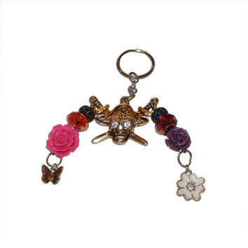 Pirate and Flower Metal, Glass and Plastic Keychain