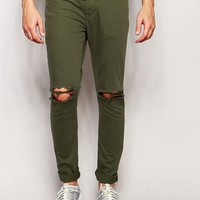 ASOS | ASOS Super Skinny Jeans With Knee Rips In Green at ASOS
