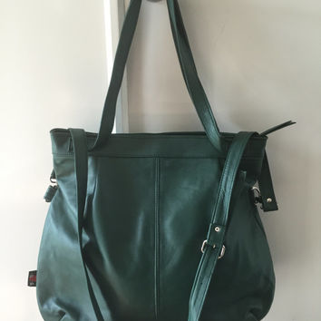 Super soft lambskin leather handbag.So unique with curved corners,shoulder and cross body straps make this tote shopper bag the perfect gift