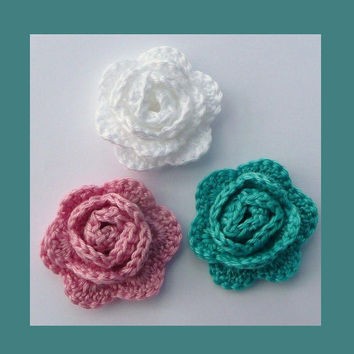 3  crochet roses, appliques and embellishments