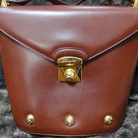 Vintage Salvatore Ferragamo brown leather trapezoidal shape purse with gold tone elegant closure. Ferragamo charms. - Edit Listing - Etsy