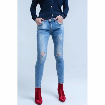 Skinny jeans with rips and pockets