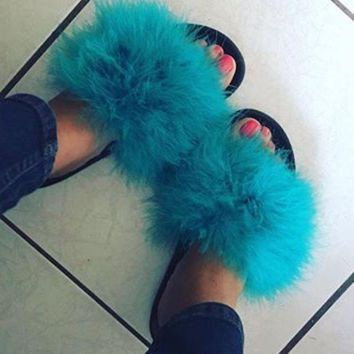 DCCKDW7 Teal Nike fur slides