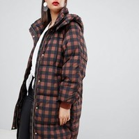 Moss Copenhagen oversized longline padded jacket in check at asos.com