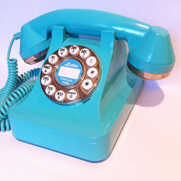Vintage blue turquoise teal aqua push button phone.  Retro telephone.