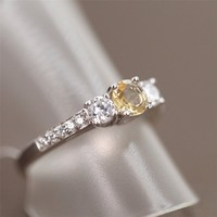 Magic Pieces Sterling Silver Ring with Round Natural Yellow Citrine and Side CZ Settings