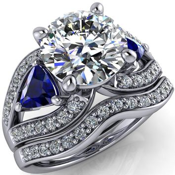 Kassandra Round Moissanite 4 Prong Trillion Blue Sapphire Side Split Shank Accent Engagement Ring