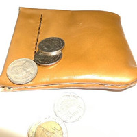 Tan leather coin purse spring closure