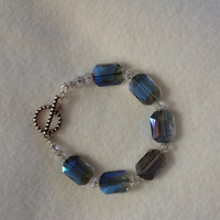 Christmas Emerald Cut Crystal Bracelet...see pale, sky blue, hint of lavender to greyed clear colors in the crystal beads.