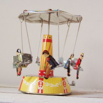 Colourful carousel miniature, vintage, tin, merry go round toy with six seated figures, retro carrousel in red yellow blue, early nineties