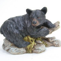 Bear Laying On A Stump Figurine