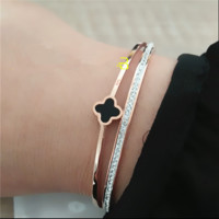 Van Cleef & Arpels:New four clover full diamond double bracelet bracelet female titanium steel rose gold fashion wild