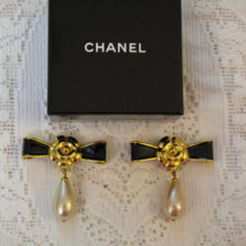 Authentic vintage Chanel black enamel & gold plated earrings with iconic camellia centers and large glass pearl drops, circa 1990