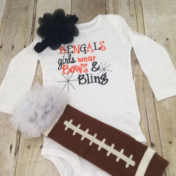 Bengals inspired girls like bling set with ruffled football leg warmers and bow.