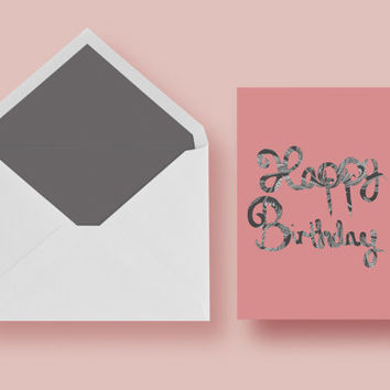 Pink Happy Birthday Card with black and white design cut out.