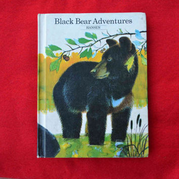 Black Bear Adventures, 1965 vintage kids book by Mary Lewis Hansen, illustrated by Altschuler, printed in the US green nature woods animals