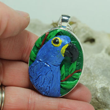 Hyacinth macaw pendant Polymer clay sculpting Bird pendant