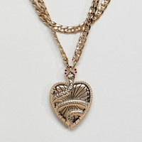 ASOS DESIGN statement multirow necklace with vintage style snake locket in gold at asos.com