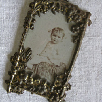 art nouveau gilded photo frame with baby photo