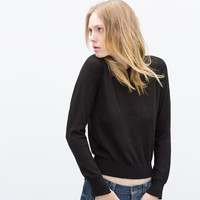 KNIT SWEATER WITH SLEEVE SLITS