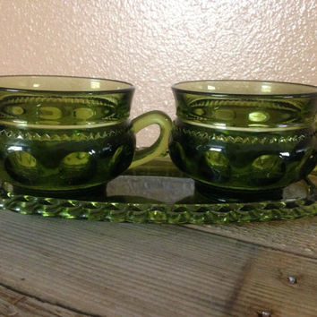Vintage carnival glass cup and saucer set