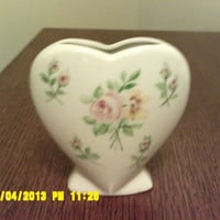 decorative heart-shaped vase with elegant flower paintings on both sides
