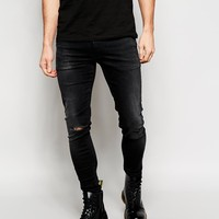 ASOS | ASOS Extreme Super Skinny Jeans With Rip at ASOS