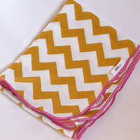 Chevron baby blanket. Blanket size: Size 31 by 40 inches. Colors- Mustard and white with pink edging.