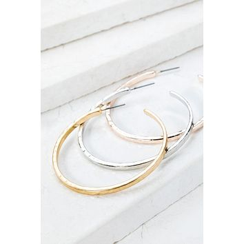 Hammered Metal Hoop Earrings in Gold