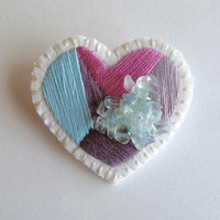 Hand embroidered heart brooch with pastels of pink, light blue, and mauve with fluorite beads on cream muslin with cream felt backing Spring