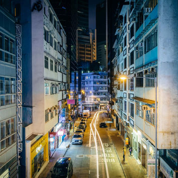 View of a narrow street at night, from the Central–Mid-Levels Escalator, in Hong Kong.