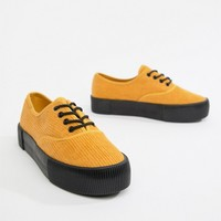 Monki courdroy flatform plimsols in Mustard/black sole at asos.com