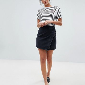 ASOS DESIGN Tall denim wrap skirt in washed black at asos.com