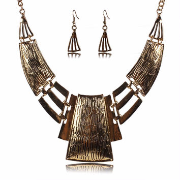 collar necklace and earrings