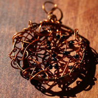 pendant wire wrapped like a spiders web by rocksntwigs on Etsy