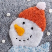 Handmade Christmas ornament, flannel snowman, wool and felt, embroidered, wearing blue scarf and orange hat, holding a tiny ornament