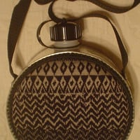 Canteen (Two quart) with chevron print cloth front, black cloth back, and black trim.