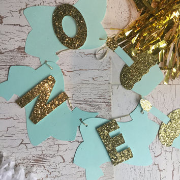 "mint and gold ""ONE""  ribbon banner. 1st birthday banner, door banner,table banner, high chair banner, name banner, age banner.for bday party"