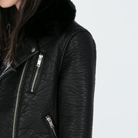Faux leather jacket with detachable fur collar
