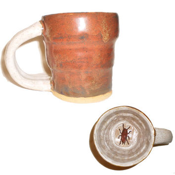 Cockroach Cup (4) - Hand-built ceramic slab cup with molded cockroach on the bottom