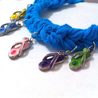 Turquoise blue fabric flip flop and dolphin tie on charm bracelet